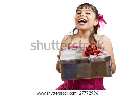 Studio shot of endearing girl with gift wearing fancy dress - focus on gift - stock photo