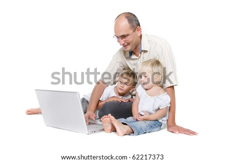 studio shot of father and two kids with laptop