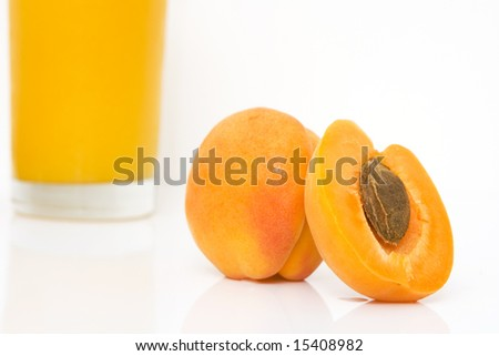 studio shot of fresh apricots with juice isolated against white background