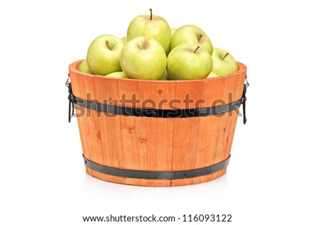 Studio shot of green apples in a wooden barrel isolated on white background - stock photo