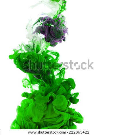 Studio shot of green ink in water, isolated on white background - stock photo