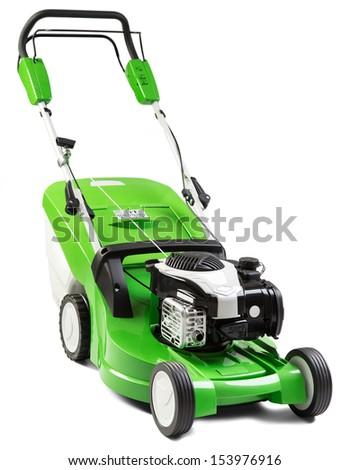 Studio shot of green lawnmower.  - stock photo