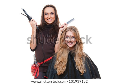 studio shot of hairdresser and blonde woman. isolated on white - stock photo