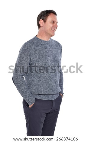 Studio shot of happy mature man standing with his hands in pocket looking away at copyspace on white background  - stock photo