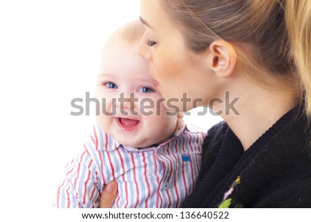 studio shot of happy mother with baby - stock photo