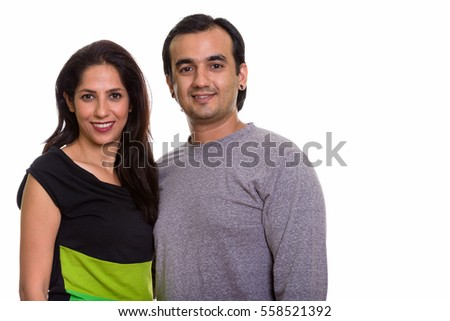 Studio shot of happy Persian couple smiling together isolated against white background