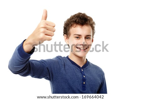 Studio shot of happy teenager making the thumbs up sign, isolated over white background - stock photo