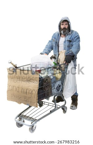 Studio shot of homeless man with beard pushing a shopping cart with all his possessions on a white background. - stock photo