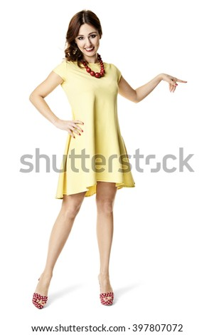 Studio shot of hostess points the finger at... - stock photo