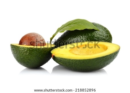 Studio shot of juicy colorful avocado with leaf and pit in the kernel core nucleus - stock photo