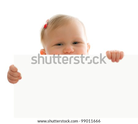 studio shot of little baby behind white board - stock photo