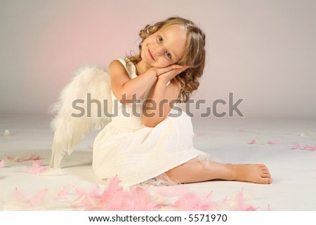 Studio shot of little girl as an angel. - stock photo