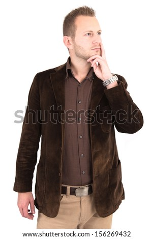 Studio shot of man pondering - stock photo