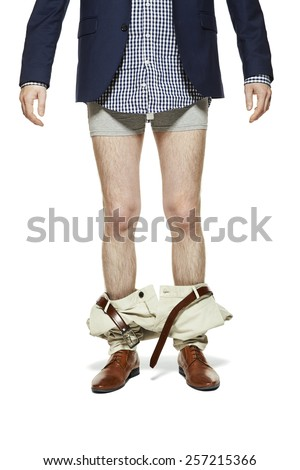 Studio shot of man with pants down. Isolated on white background.  - stock photo