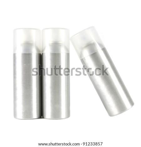 Studio shot of many spray can on white - stock photo