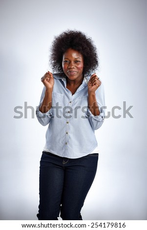 Studio shot of mature african woman feeling happy on white background - stock photo