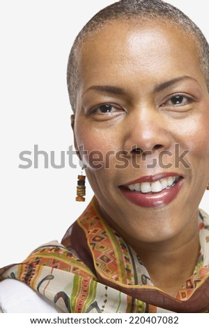 Studio shot of middle-aged African woman smiling - stock photo