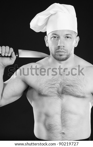 Studio shot of muscular caucasian shirtless chef with a kitchen knife, black and white image - stock photo