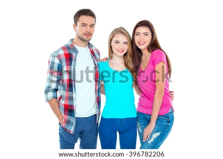Studio shot of nice young friends. Beautiful people looking at camera and smiling. Isolated background - stock photo