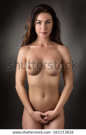 studio shot of nude woman covering her vagina - stock photo