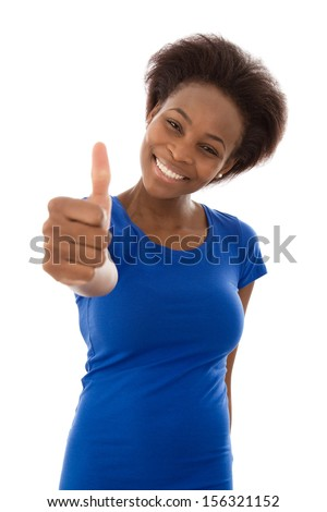 Studio shot of pretty African American woman with thumb up - stock photo