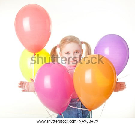 studio shot of pretty  little girl with balloons - stock photo