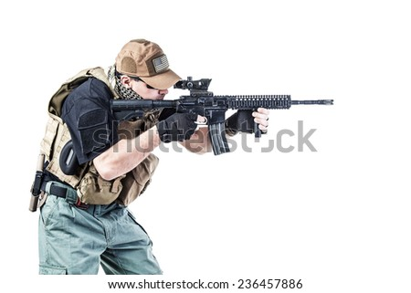 Studio shot of private military contractor PMC with assault rifle - stock photo