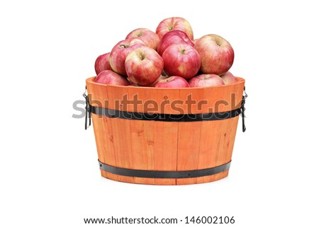 Studio shot of red apples in a wooden barrel isolated on white background - stock photo