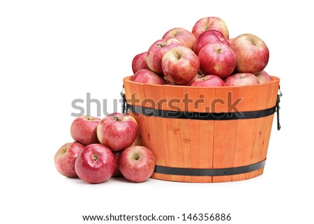 Studio shot of red apples in a wooden bucket isolated on white background - stock photo