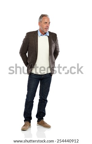 Studio shot of relaxed mature man looking away at copyspace on white background