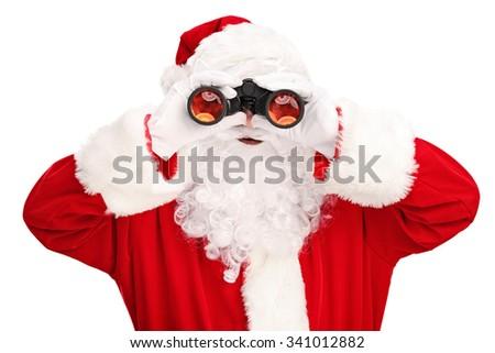 Studio shot of Santa Claus looking through binoculars isolated on white background - stock photo