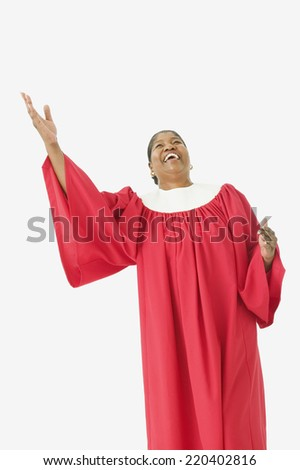Studio shot of senior African woman wearing a choir robe and singing - stock photo