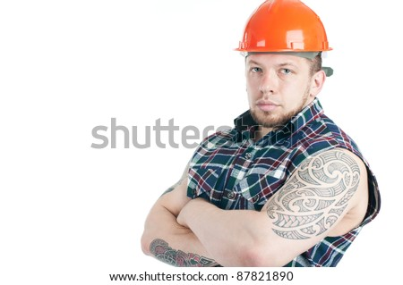 Studio shot of serious tattooed caucasian construction worker over a white background - stock photo