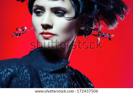 Studio shot of Sexy Fashion Woman in Black Dress. Professional Makeup and Hairstyle