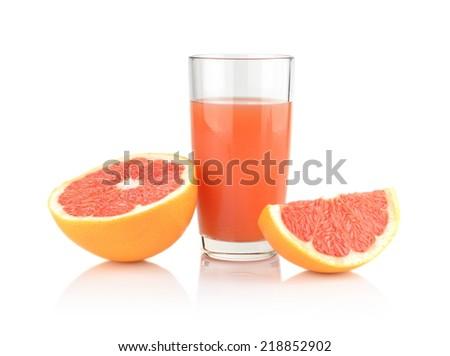 Studio shot of sliced grapefruit with juice isolated on white background - stock photo