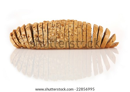 Studio shot of sliced loaf of bread on light table. - stock photo