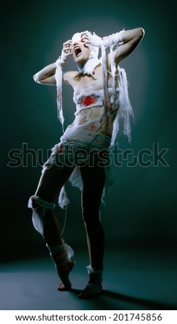 Studio shot of slim model posing as scary mummy - stock photo