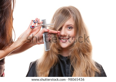 Studio shot of smiley woman and hairdresser. white background - stock photo