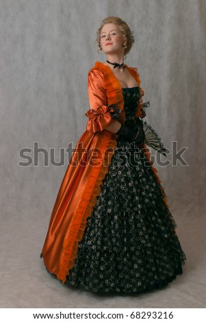 studio shot of standing girl with baroque dress and hairstyle