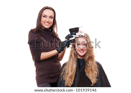 studio shot of stylist with client. isolated on white - stock photo