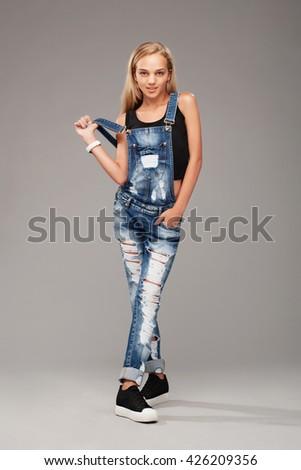 Studio shot of teenage stylish girl - stock photo