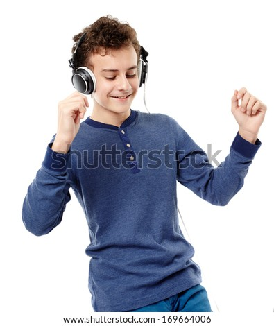 Studio shot of teenager dancing and listening to music at headphones, isolated over white background