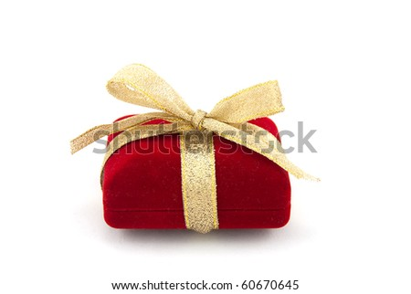 Studio shot of the red gift box with golden ribbon
