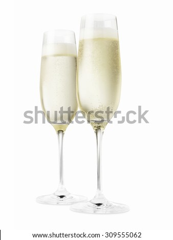 Studio shot of two champagne glasses isolated on a white background. - stock photo