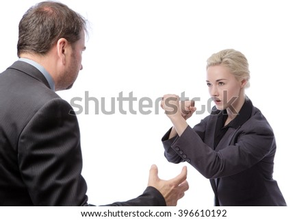 Studio shot of two co-workers wearing suits, fighting in the office, isolated on a white background.