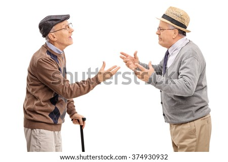 Studio shot of two senior gentlemen arguing with each other isolated on white background - stock photo