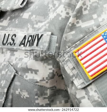 Studio shot of US flag shoulder patch on solder's uniform - stock photo