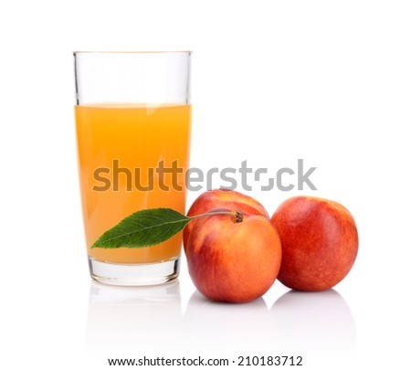 Studio shot of whole red and orange nectarines with leaf and nectarine juice isolated on a white background