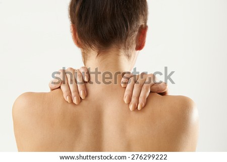 Studio Shot Of Woman With Painful Neck - stock photo