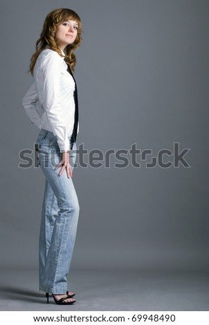Studio shot of young beautiful female model wearing tie - stock photo
